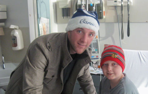 Cam Barker visits a boy in the hospital